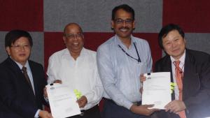 Mr. Victor Chung, CEO, Jinpao, Thailand, Prof. P. P. Mujumdar, Chairman, ICWaR, Mr. V. Rajarajan, Registrar, Indian Institute Of Science, Bangalore, and Mr. T. Takagi, CEO, alfaTKG, Japan showing the signed MoA.
